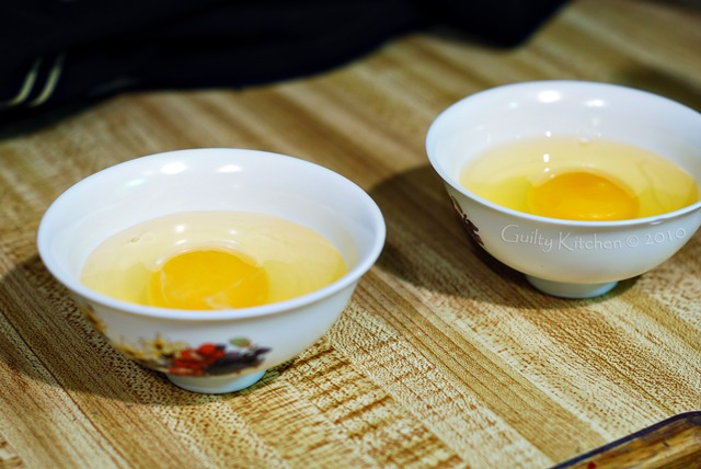 Eggs in cups, waiting to be transferred to simmering water
