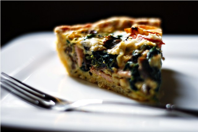 A slice of fully loaded quiche